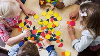 Children play with coloured shapes