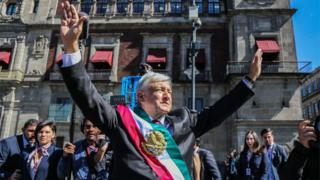The new President of Mexico, Andres Manuel Lopez Obrador (C), arrives at the National Palace, in Mexico City