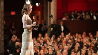 Emma Stone accepts Best Actress award at the Academy Awards.