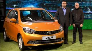 Tata Motors Chairman Cyrus Mistry, left, and Tim Leverton, head of Tata Engineering and Research and Development, pose for photographers during the unveiling of Zica at a press preview of Auto Expo in Greater Noida, near New Delhi, India, Wednesday, Feb. 3, 2016.