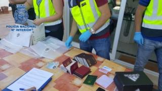Spanish police with fake passports - 3 August 2017