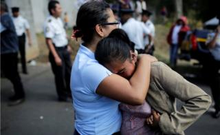 Family members react as they wait for news of their loved ones after a fire broke out at the Virgen de Asuncion home in San Jose Pinula on the outskirts of Guatemala City, March 8, 2017