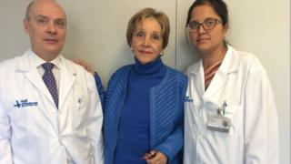 Maria Jose del Valle with two doctors.