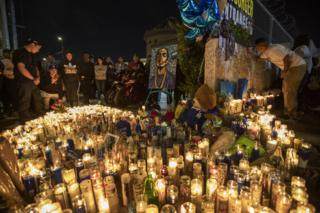 People mourn for rapper Nipsey Hussle on 1 April 2019 in Los Angeles, California.