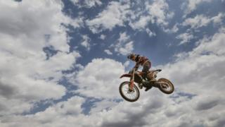 An African rider competes during the FIM AFRICA Motocross of African Nations Continental Championship held in Nairobi, Kenya, 21 August 2016. This year's annual continental championship saw riders representing South Africa, Kenya, Uganda, Botswana, and Zambia including women and children