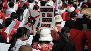 Female protesters call for South Korea's government to crack down on widespread spycam porn crimes during a rally in Seoul