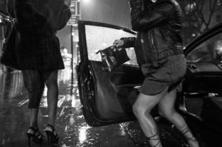 Women get out of the car in the rain