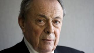 File image of former French prime minister Michel Rocard, who poses for Reuters in his office in Paris, November 5, 2009