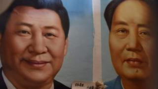 This photo taken on September 19, 2017 shows painted portraits of Chinese President Xi Jinping (L) and late communist leader Mao Zedong at a market in Beijing.