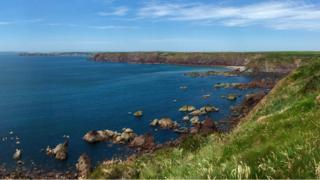 Sweeping view of the bay and coastal cliffs