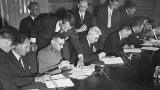 Signing the Geneva Convention in 1949