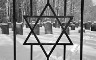 Star of David in railings of Jewish cemetery