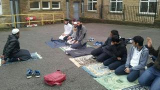 Students praying outdoors at Mirfield