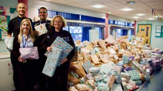 Essex Police officers with a pile of presents