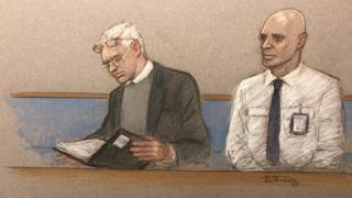 Julian Assange (left) at Woolwich Crown Court