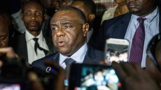 Congolese opponent Jean-Pierre Bemba (C), speaks to the press after applying to be a candidate for next presidential elections of December 23