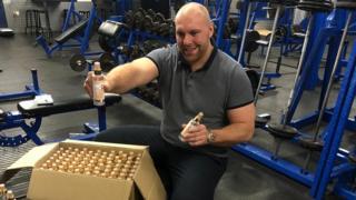 Luke Willmott with 1,000 bottles of hand gel
