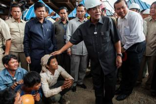 Cambodian Prime Minister Hun Sen makes his first public visit to the construction site of a bridge South of Phnom Penh on July 31, 2013 in Phnom Penh, Cambodia.
