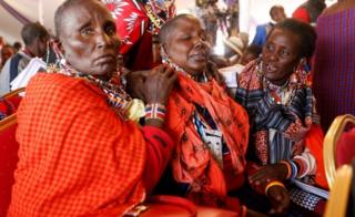 Maasai women mourn Kenya's Interior Minister Joseph Nkaissery before his burial ceremony in Ilbissil village of Kajiado county, Kenya, July 15, 2017.