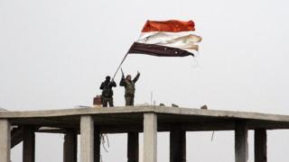 Бойцы под сирийским флагом