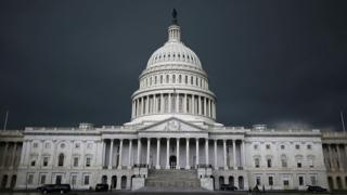 Storm clouds gather over US Capitol buidling.