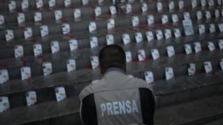 The credentials of journalists killed in Mexico are laid out at a memorial in Guadalajara in 2017
