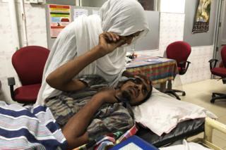 Mohammad Razak Taslim in hospital, with his wife