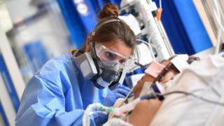 A medical worker wearing a protective face mask at the Royal Papworth Hospital in Cambridge