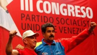 Venezuela's President Nicolas Maduro (right) embraces Gen Hugo Carvajal as they attend the Socialist party congress in Caracas on 27 July, 2014