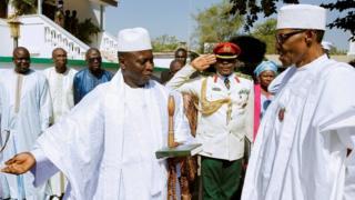 Gambian President Yahya Jammeh welcoming Nigeria's leader, Muhammadu Buhari, to Banjul