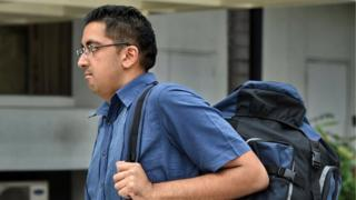 British national Yogvitam Pravin Dhokia arrives at the state court in Singapore