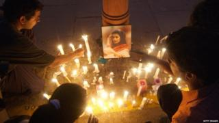 Indian protesters light candles around a photographs of murdered woman Jessica Lal during a protest at India Gate in New Delhi, 04 March 2006.