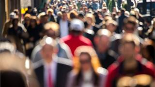 a stock image of a crowd of people