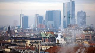 Smoke billows from chimneys in Milan, Italy, Tuesday, Dec. 22, 2015.