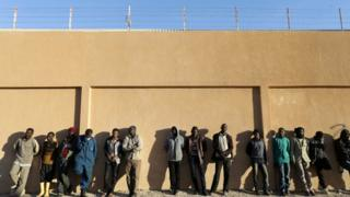 "Migrants stand in a detention centre run by the interior ministry of Libya""s eastern-based government, in Benghazi, Libya, December 13, 2017."