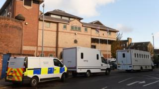 HMP Bedford with a police van outside