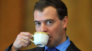 Dmitry Medvedev drinking from a coffee cup