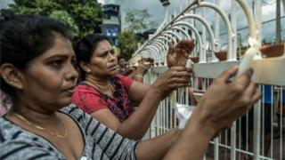 Sri Lankan local people lit candles near to St Anthony Church in Colombo following the bombings