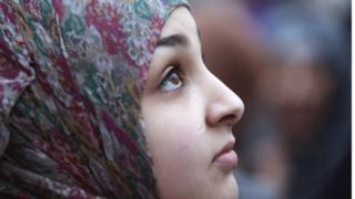 A young woman wearing a headscarf