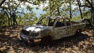 A burned truck is pictured at the Comedero Colorado ranch, in the municipality of Tamazula, Durango State, on 18 October 2015.