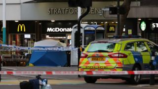 Police in Stratford, east London after a male teenager was fatally stabbed outside Stratford Broadway