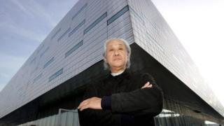 Japanese architect Arata Isozaki poses in front of the Palahockey palace designed with Italian architect Pier Paolo Maggiora in Turin, Italy, on 20 December 2005