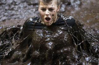 A contestant in The Muddy Trials