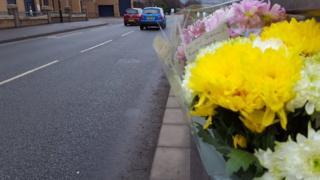 Flowers at scene of pensioner's death