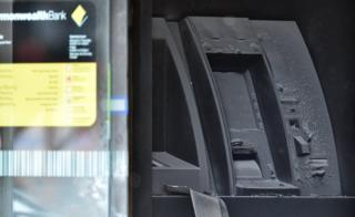 A fire-damaged cash machine at the Commonwealth Bank Springvale in Melbourne (18 November)