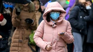 Woman in London wearing a face mask