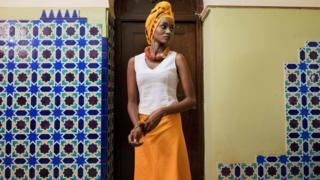 A model waits to go on stage during the opening night of the Swahili Fashion Week being held at the National Museum in Dar es Salaam, Tanzania on December 2, 2016.