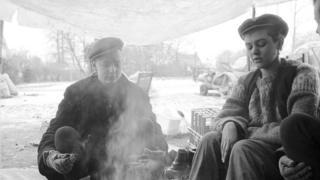 Women sitting around a camp fire