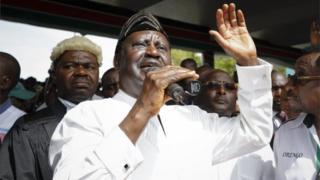 TJ Kajwang (L) and Raila Odinga