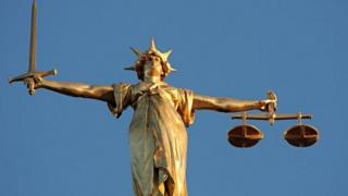 Scales of justice, at the top of the dome of the Central Criminal Court, London